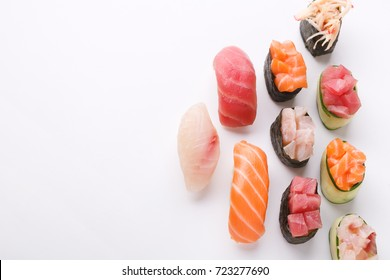 Set of sushi and maki isolated at white background, top view. Salmon, tuna and seebas nigiri. Asian healthy restaurant food delivery