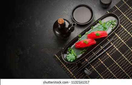 Set of sushi and maki roll . on dark background .Top view