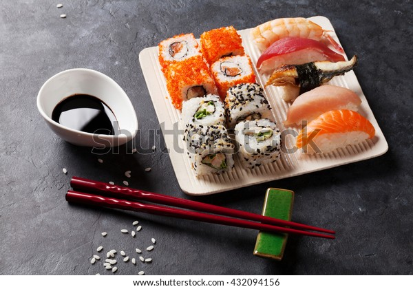 Set of sushi and maki roll on stone table