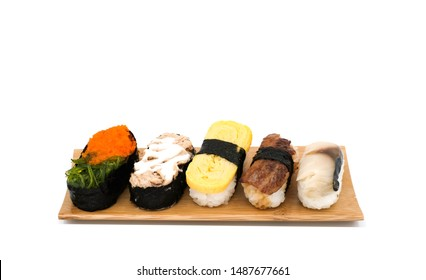 Set of sushi on bamboo wooden plate isolated on white background, Japanese food concept