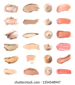 Set with swatches of lipsticks, eye shadows and skin foundations on white background, top view
