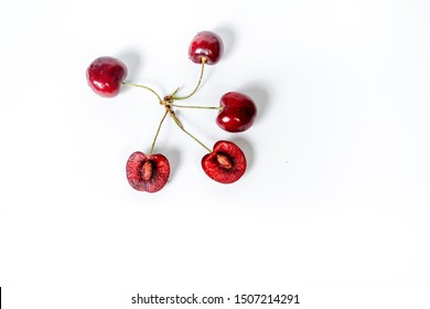 Set sweet cherry berry. two cut in half with bone, Three a branch  and single isolated on white background. Clipping Path. Full depth of field.