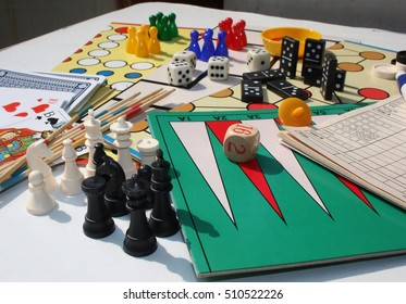 Set of table games with white and black chess pieces in the foreground