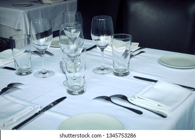 set table restaurant plate wine glass white tablecloth and napkin