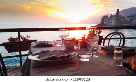 Set table with suggestive sundown on Camogli city