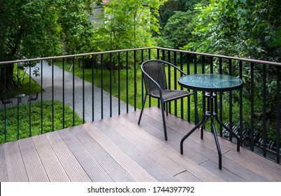 A set of tables and chairs to relax in the balcony with nature background
