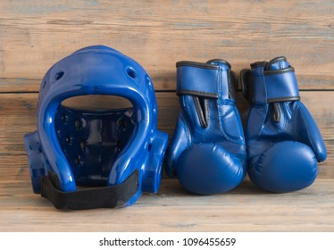 set Taekwondo equipment on a wooden background stock photos. Sports, martial arts. Protective equipment for fight in full contact