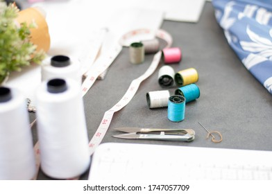Set of Tailor accessories.Sewing accessories and fabric. Fasion Design online working place. Sewing colored threads. Fashion Design working studio. Fashion Industry.