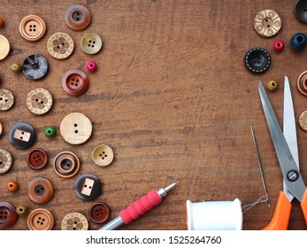 Set of tailoring tools on wooden table, Sewing accessories, Crafting tools in work shop, Top view with copy space.