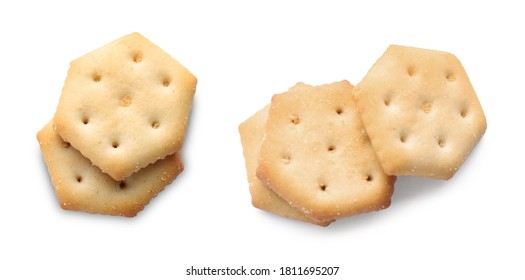 Set of tasty crispy crackers on white background, top view