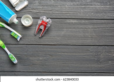 Set for teeth cleaning on wooden background