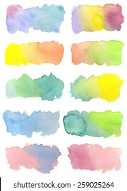 Set of ten hand-painted watercolor labels in bright colors with pretty gradations. Rainbow hues reminiscent of Spring. White background. Hand drawn using transparent watercolor paint on paper.
