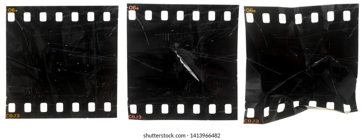 set of three black and exposed 35mm filmstrips or snips with scratches and marks on white background, rumpled film material