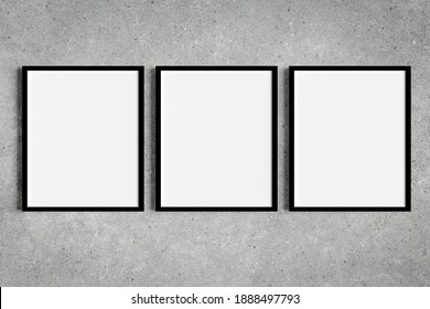 Set of three black portrait picture frame mockups on grey wall