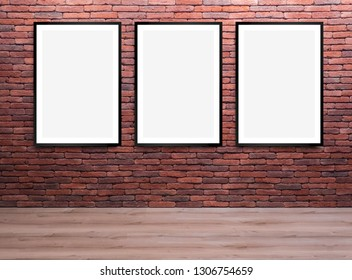 Set of three blank, vertical framed posters, on a brick wall, mock up