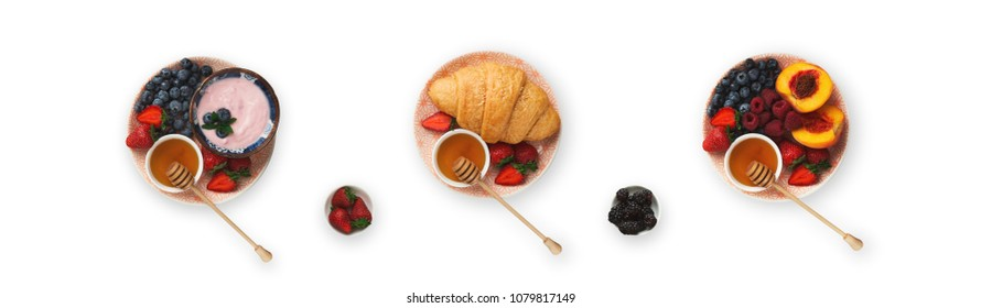 Set of three breakfast dishes, isolated on white. Top view on platters with yogurt, berries, fruits and croissants. Collage of morning meals, cutout for menu