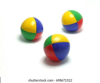 Set of three colorful juggling balls on a white surface