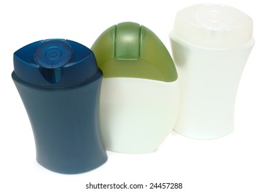 Set of three different beauty and hygiene products. On isolated background.