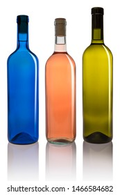 Set of three different colored bottles on white background