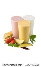 Set of three Indian traditional yogurt milk shakes lassi or smoothie isolated on white background - plain, banana and strawberry flavored