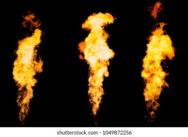 Set of three isolated fire pillars. Flame tongue goes from gas burner.