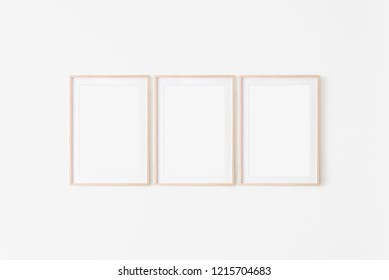 Set of three large 50x70, 20x28, a3,a4, Wooden frame mockup with backing board on white wall. Poster mockup. Clean, modern, minimal frame. Empty fra.me Indoor interior, show text or product