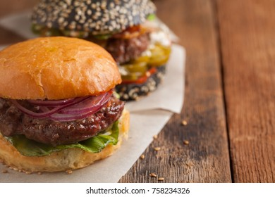 Set of three mini homemade Burger with marble beef and vegetables on a old wooden background. the concept of junk food and fast food. with copy space
