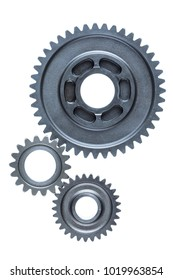 A set of three old steel gears are linked together over a bright white background.