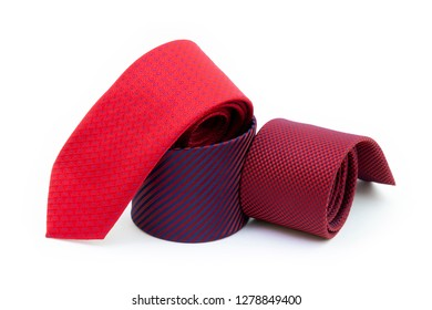 Set of three rolled red neckties isolated on white background. Fashion and shopping concept