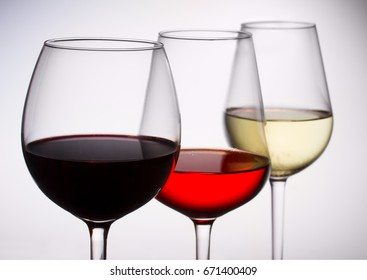 Set of three wine glasses with red, white and rose wine close up