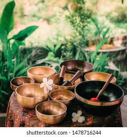 Set of tibetan singing bowls for yoga, spa salon, meditation, sound massage and healing, spiritual practices. Square image