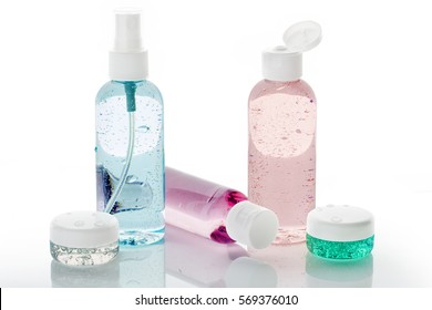 set of toiletries with water droplets on white background