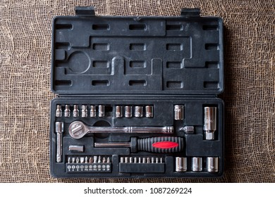 Set of tools with attachments and adapters for twisting nuts and bolts, screws of various configurations