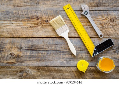 set of tools for build and repair house on wooden background top view mock-up