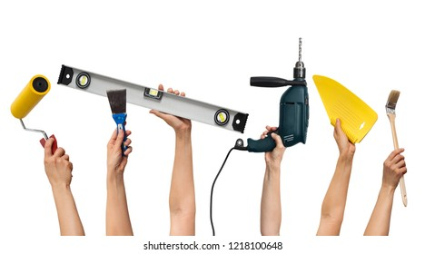 set of the tools for home repair in hands, on white background