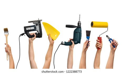 set of the tools for home repair in human hands, on white background