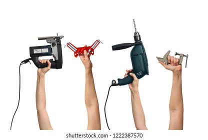 set of the tools for homework in hands, on white background