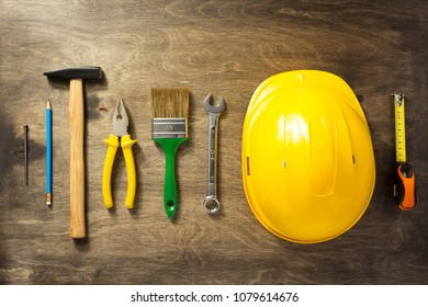 set of tools and instruments at wooden background