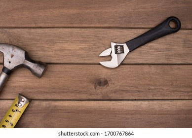 Set of tools isolated over wooden background