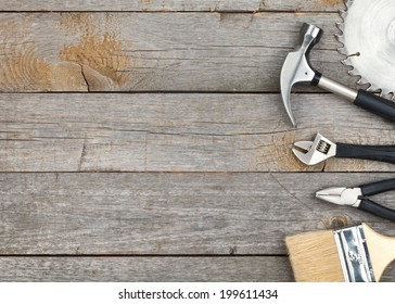 Set of tools on wood panel background with copy space