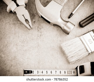 set of tools on wooden texture
