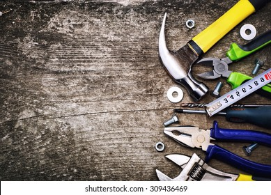 Set of tools over a wood background .