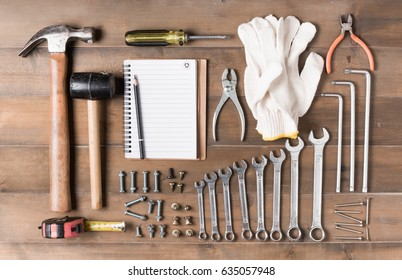 Set tools supplies with blank notebook on wood background top view. construction industry flat lay concept