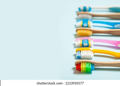 Set of toothbrushes on blue background. Concept toothbrush selection, bamboo eco-friendly and plastic. Copy space for text