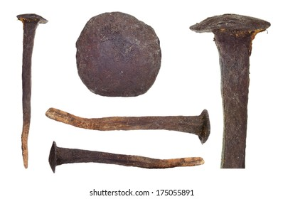 Set of traditional, hand-made, rusty, corroded, old, big nails isolated on white background.
