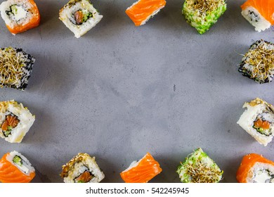 Set of traditional Japanese sushi on a dark background. Top view with a copyspace
