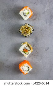 Set of traditional Japanese sushi on a concrete background. Top view