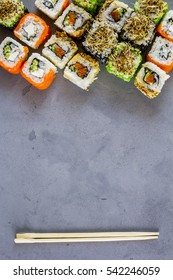 Set of traditional Japanese sushi on a concrete background. Top view with a copyspace