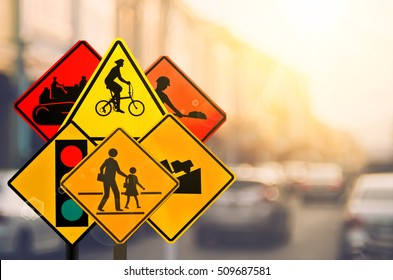 Set of traffic warning sign on blur traffic road with colorful bokeh light abstract background. Copy space of transportation and travel adventure concept. Retro tone filter color style.