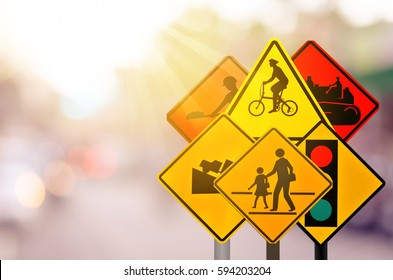 Set of traffic warning sign on blur traffic road with colorful bokeh light abstract background. Copy space of transportation and travel concept. Retro tone filter effect color style.